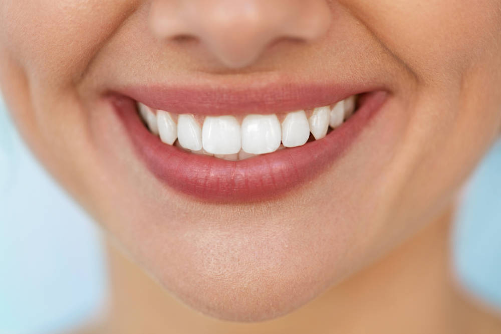 a close up of a beautiful woman's smile showing her white teeth